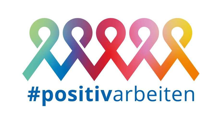 Kampagnelogo mit fünf regenbogenfarbenen AIDschleifen.